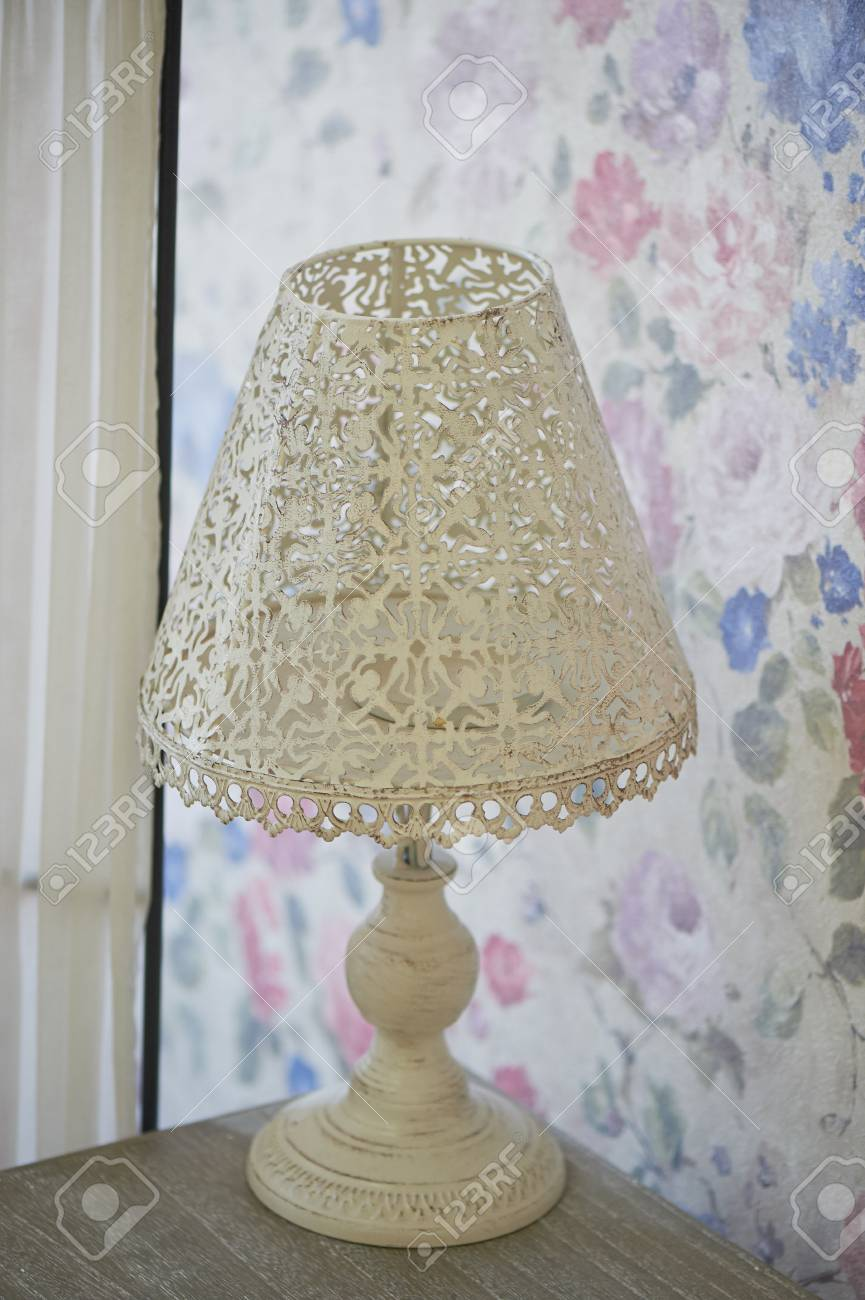 White Openwork Metal Table Lamp Stands On A Bedside Table Bright Stock Photo Picture And Royalty Free Image Image 77582072