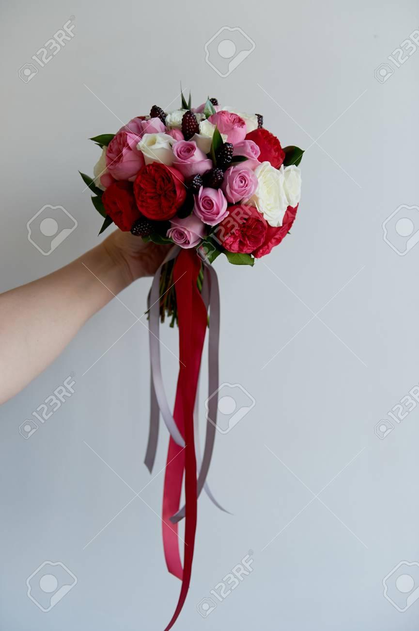 wedding bridal bouquet in red, pink, white. wedding flowers,..
