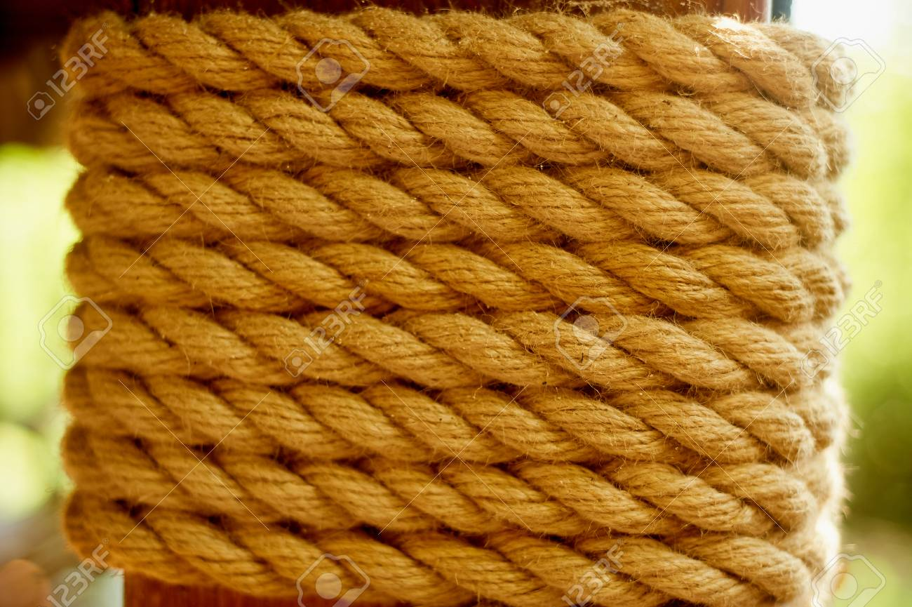 Decorative element  A thick wooden beam wrapped with rope