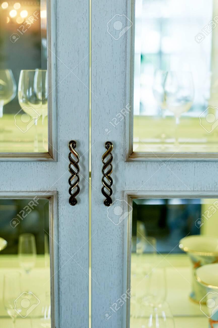 Doors glass Cabinet with utensils in the living room.