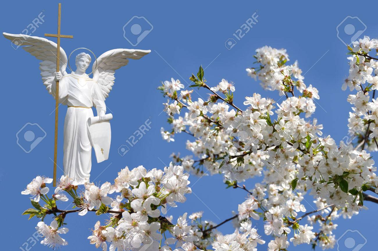 White angel and white flowers cherry on sky background stock photo stock photo white angel and white flowers cherry on sky background mightylinksfo