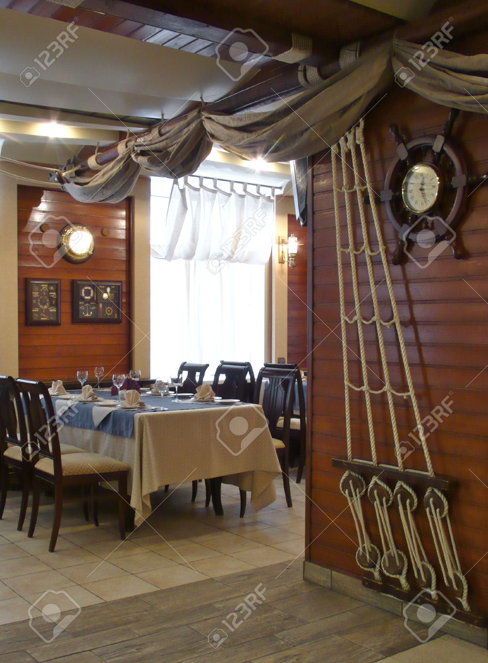 Interiors restaurant nautical style slogan tables ornaments from ropes on the walls