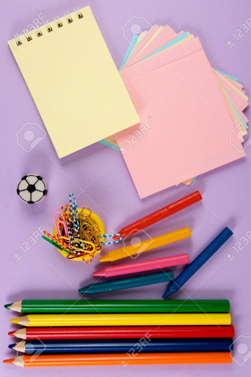 Crayons, paper, pencil, clips. At liliac background. The model for posting your pictures or inscriptions. Stock Photo - 3485727