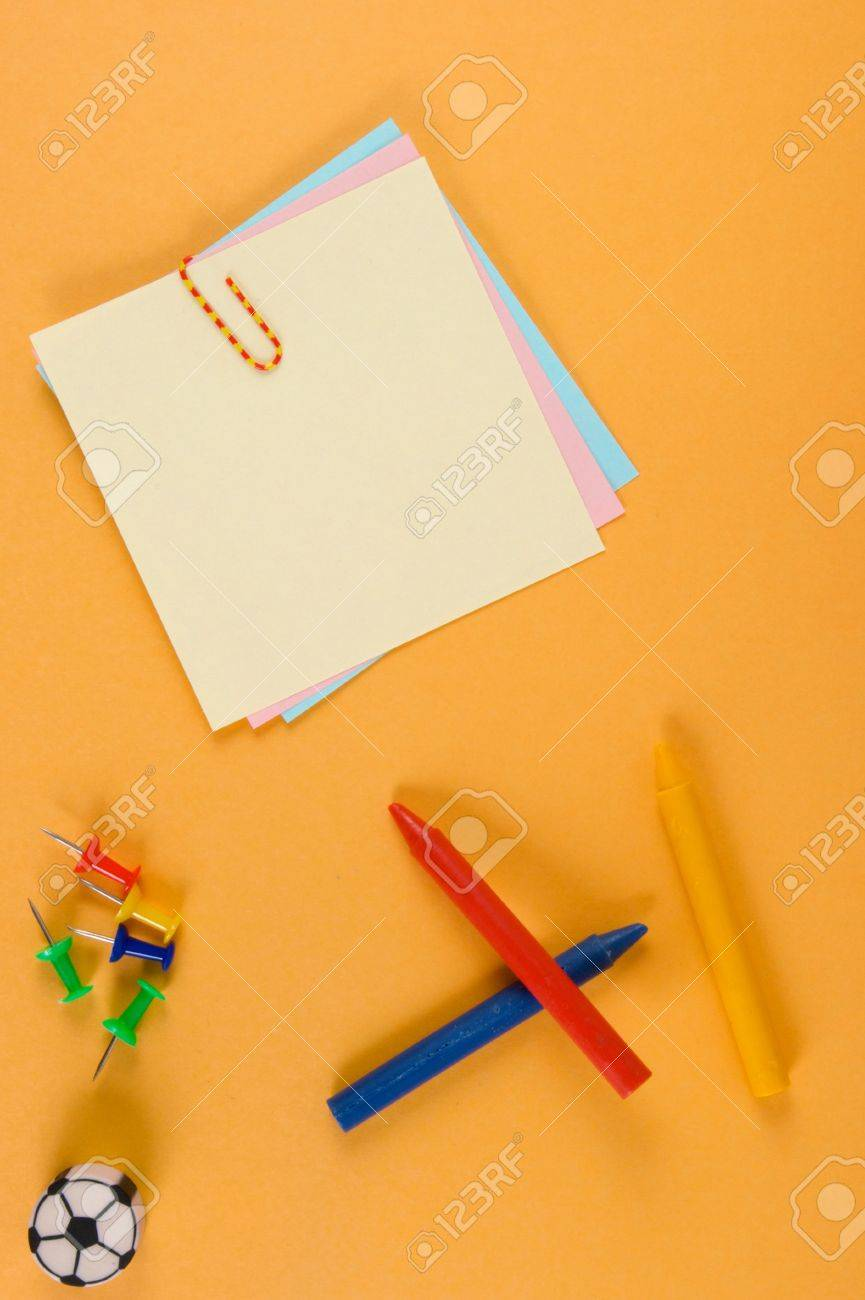 Notes, crayons, pins, eraser - to orange paper. A design to accommodate your photo or inscriptions. Stock Photo - 3485724
