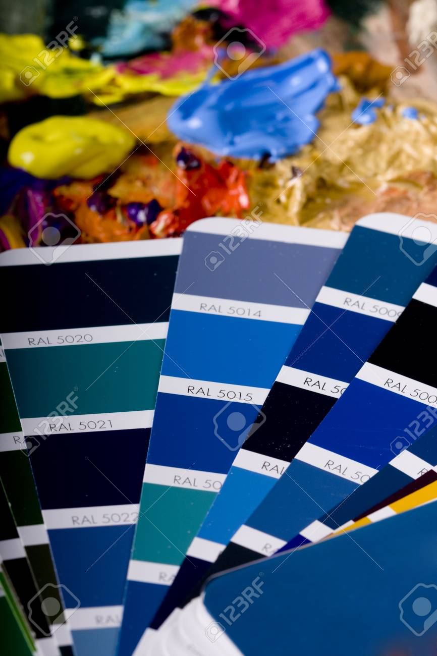 Artistic equipment: paint, brushes and knives on paint background Stock Photo - 6389848