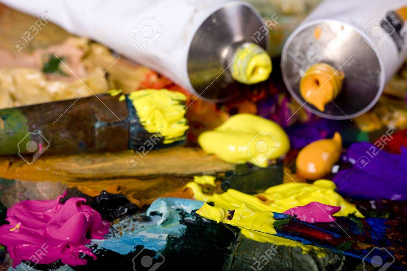 Artistic equipment: paint, brushes and knives on paint background Stock Photo - 6438979
