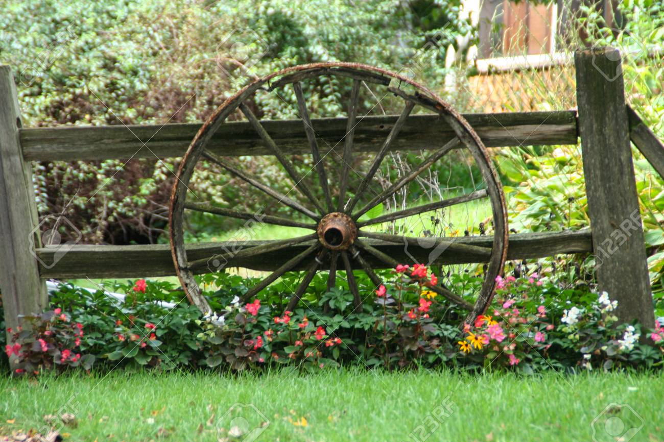 Picture Of A Fence With A Old Wagon Wheel Leaning Aginst It And Stock Photo Picture And Royalty Free Image Image 108608984