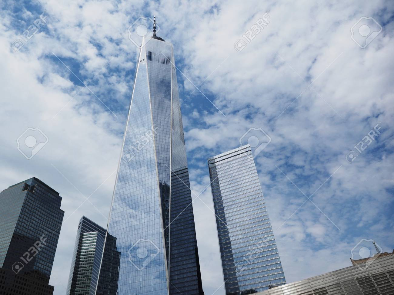 Low-angle shot of One World Trade center tower from the Memorial