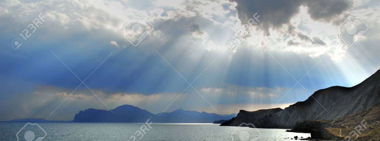 The sky and mountains. Gleams of the sun through dense overcast above mountains Stock Photo - 1745901