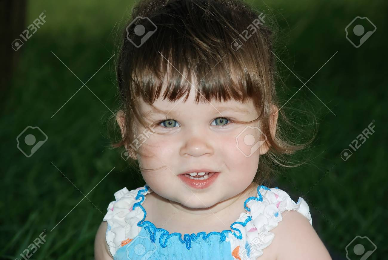 Portrait of the little girl with hair developing on a wind Stock Photo - 1755052