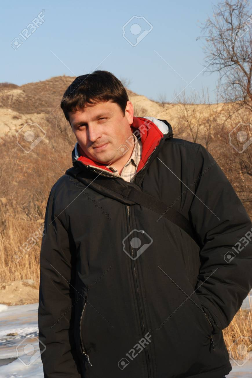 Young the man. The man the European in a jacket and a backpack Stock Photo - 2402705