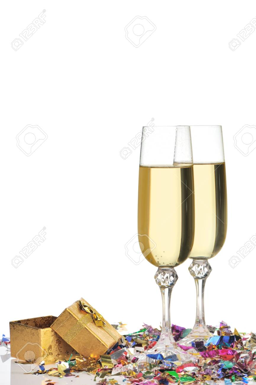 Glasses of a champagne. A celebratory tinsel and a box with a gift Stock Photo - 5617633