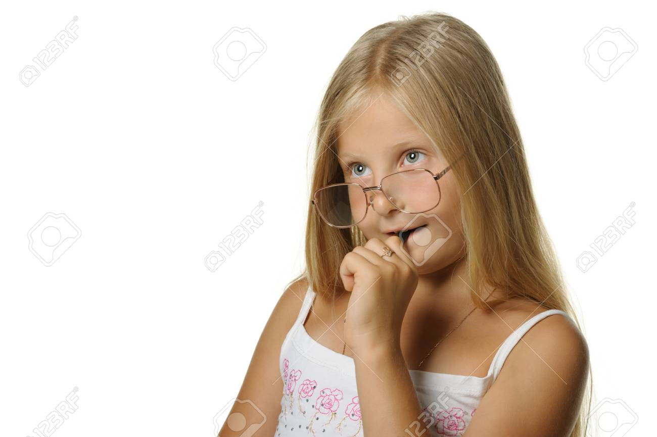 The thoughtful girl the blonde in glasses and with pen. It is isolated on a white background Stock Photo - 7395692