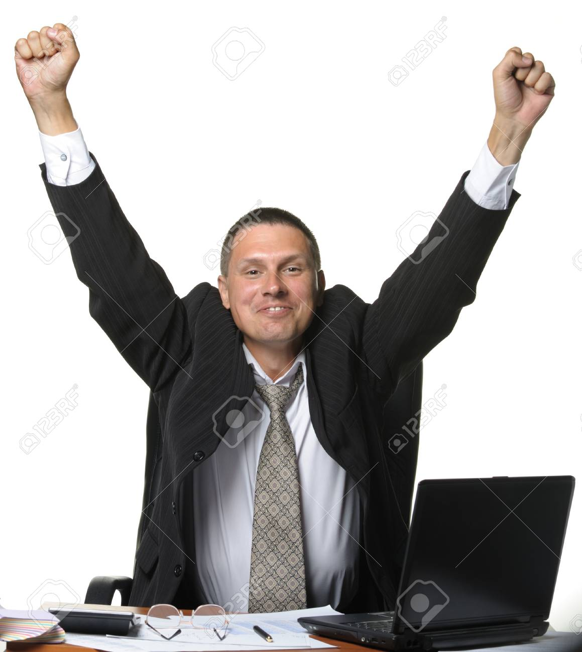 The businessman on a workplace. Concept of success. It is isolated on a white background Stock Photo - 7422590