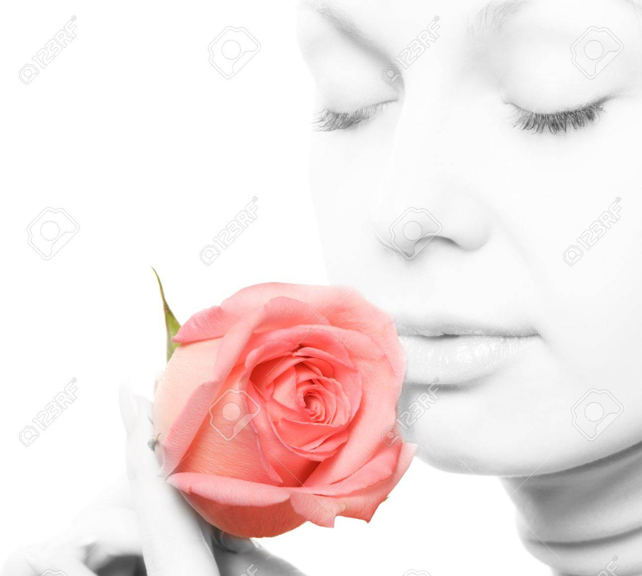 The woman with a rose close up. The monochrome image of the woman and a color rose Stock Photo - 8207074
