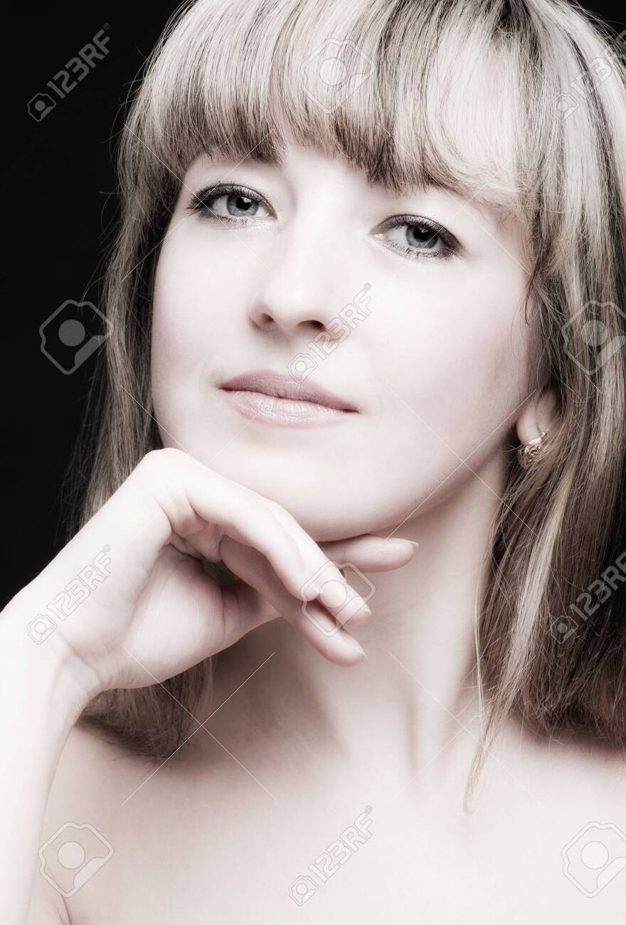 Portrait of the woman close up. The bared shoulders. Toned image. Stock Photo - 8818076