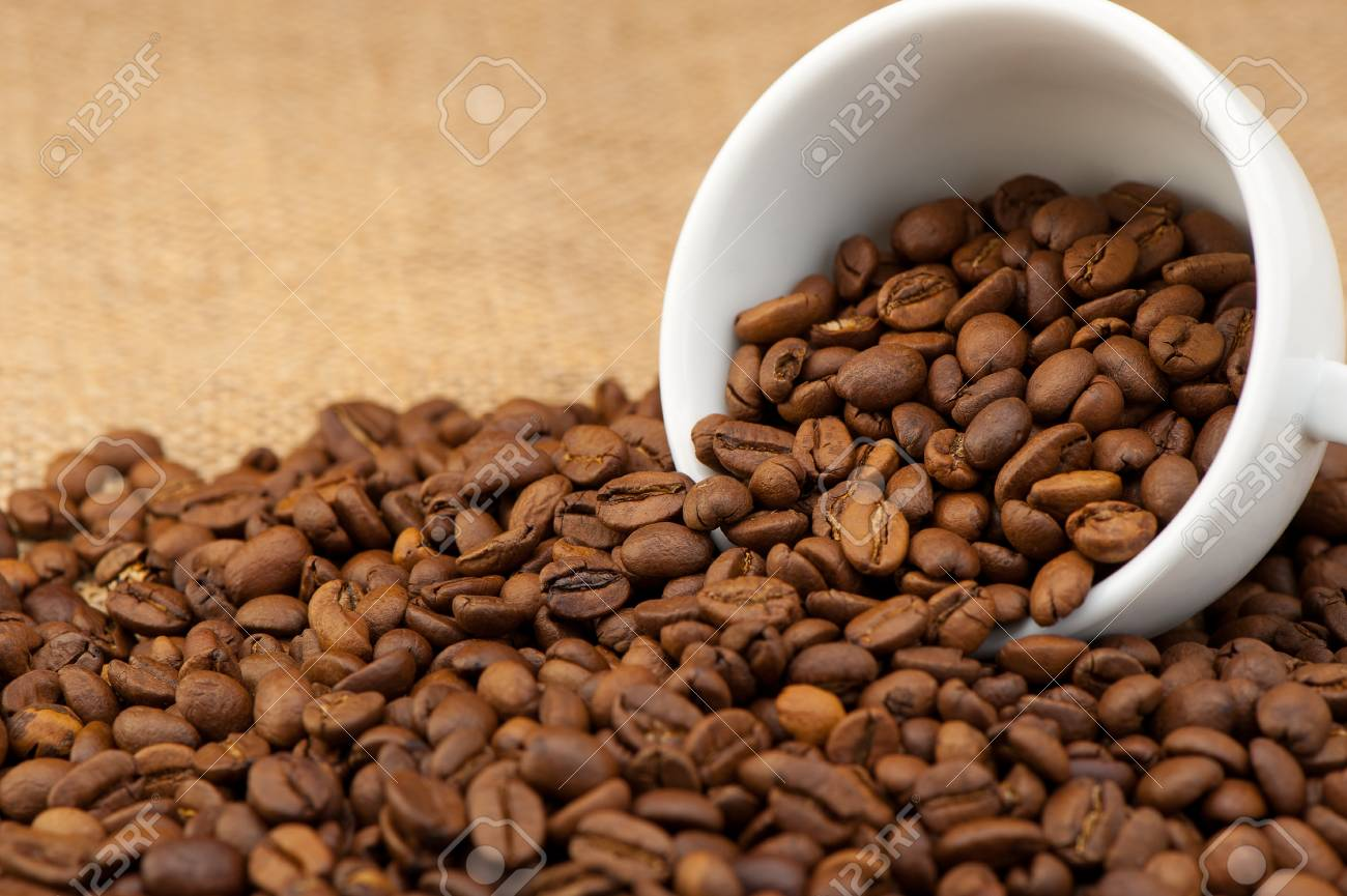 White cup with coffee grains. Grunge background Stock Photo - 9638021