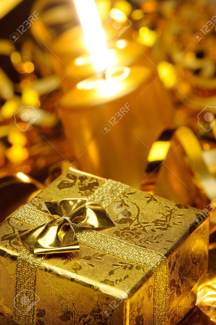 Christmas candles and gift boxes. Gold color Stock Photo - 10563776