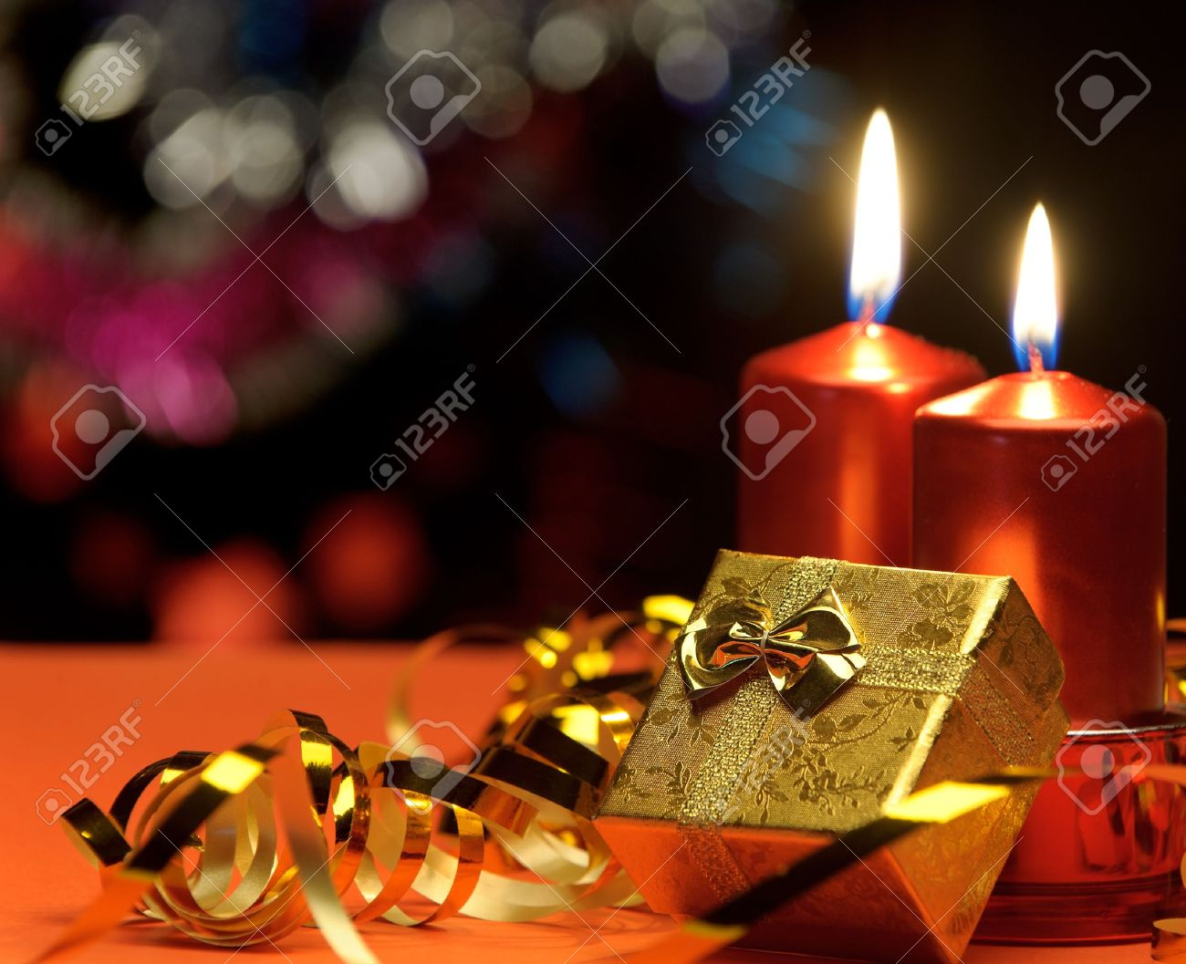 christmas candles and gift boxes a celebratory composition stock