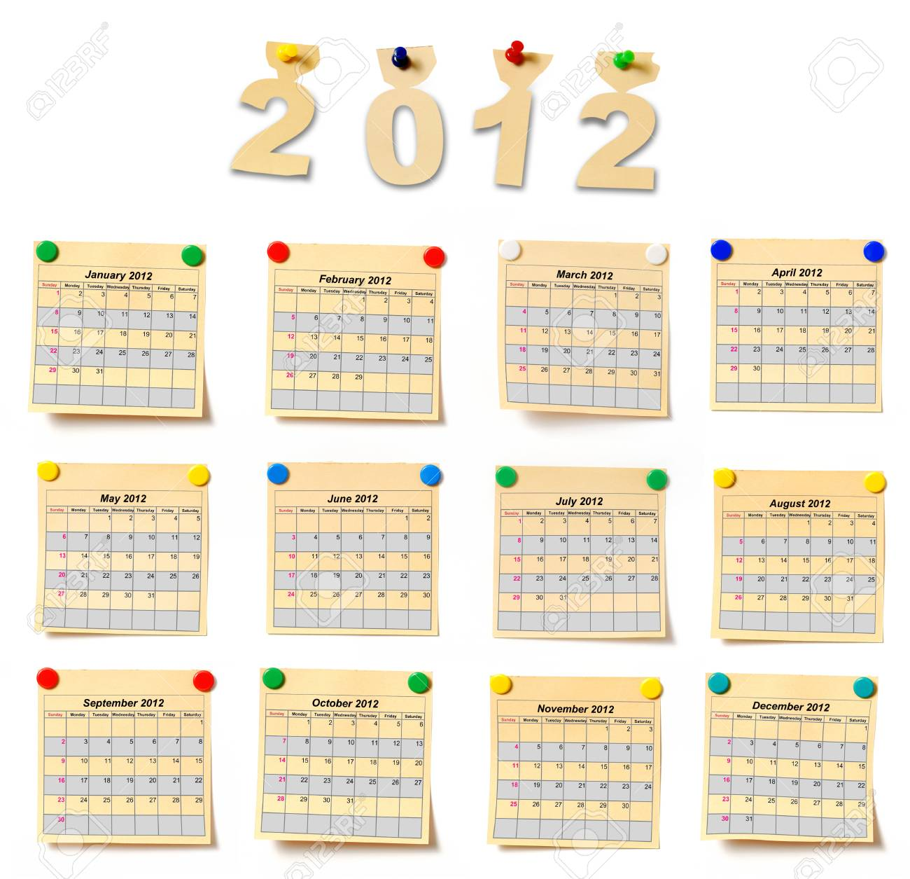 calendar on set note 2012. Paper a note attached to a wall buttons, it is isolated on a white background Stock Photo - 10695055