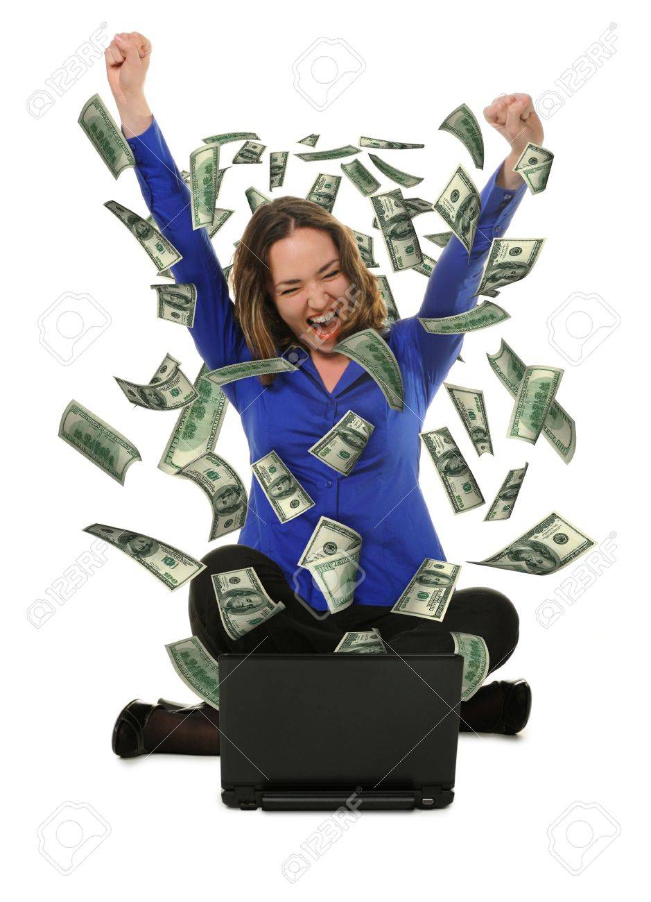 The woman in front of the laptop with fly out dollars. It is isolated on a white background Stock Photo - 10695040