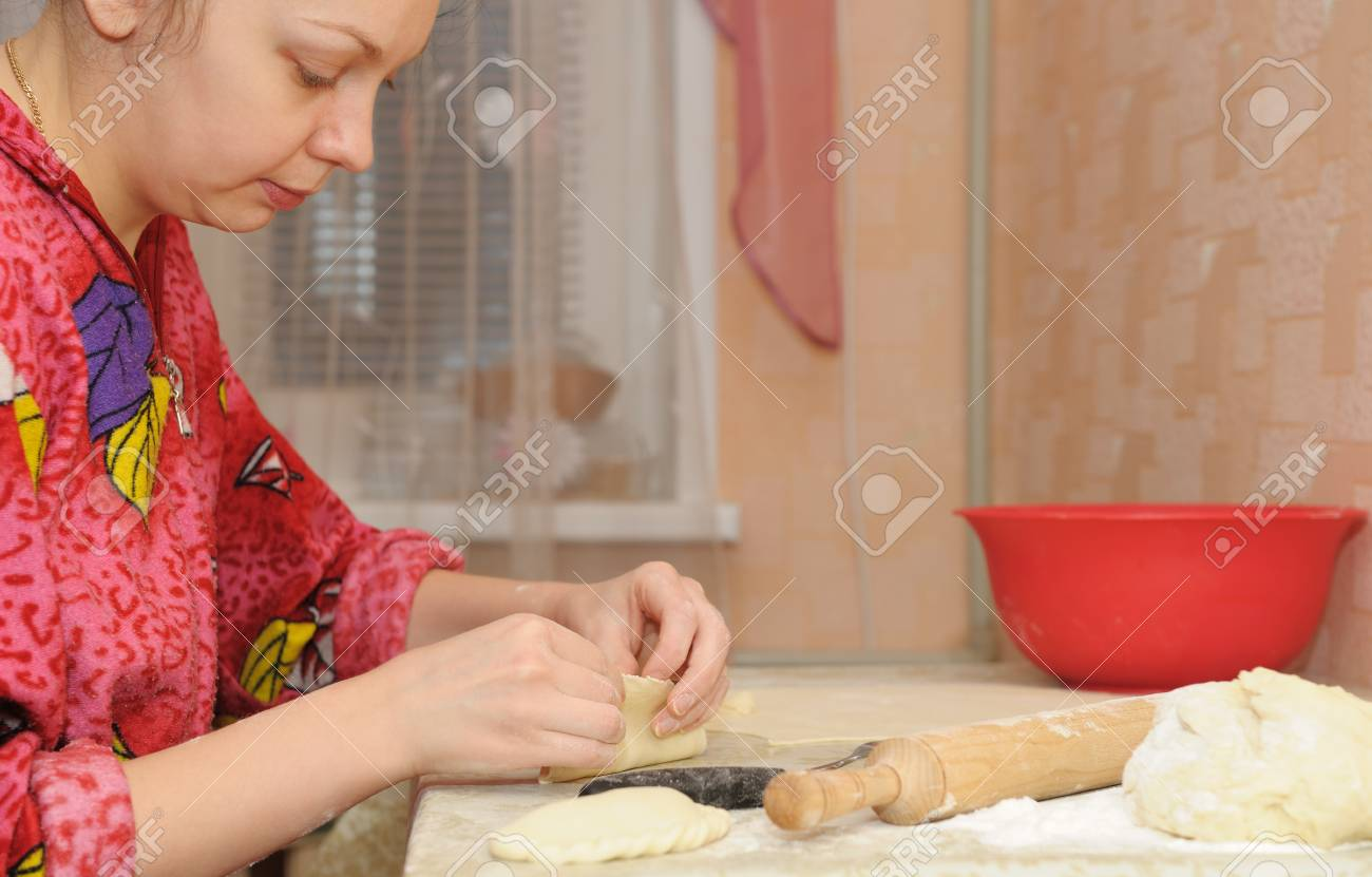 The woman prepares a pie. House conditions, cooking Stock Photo - 11585852