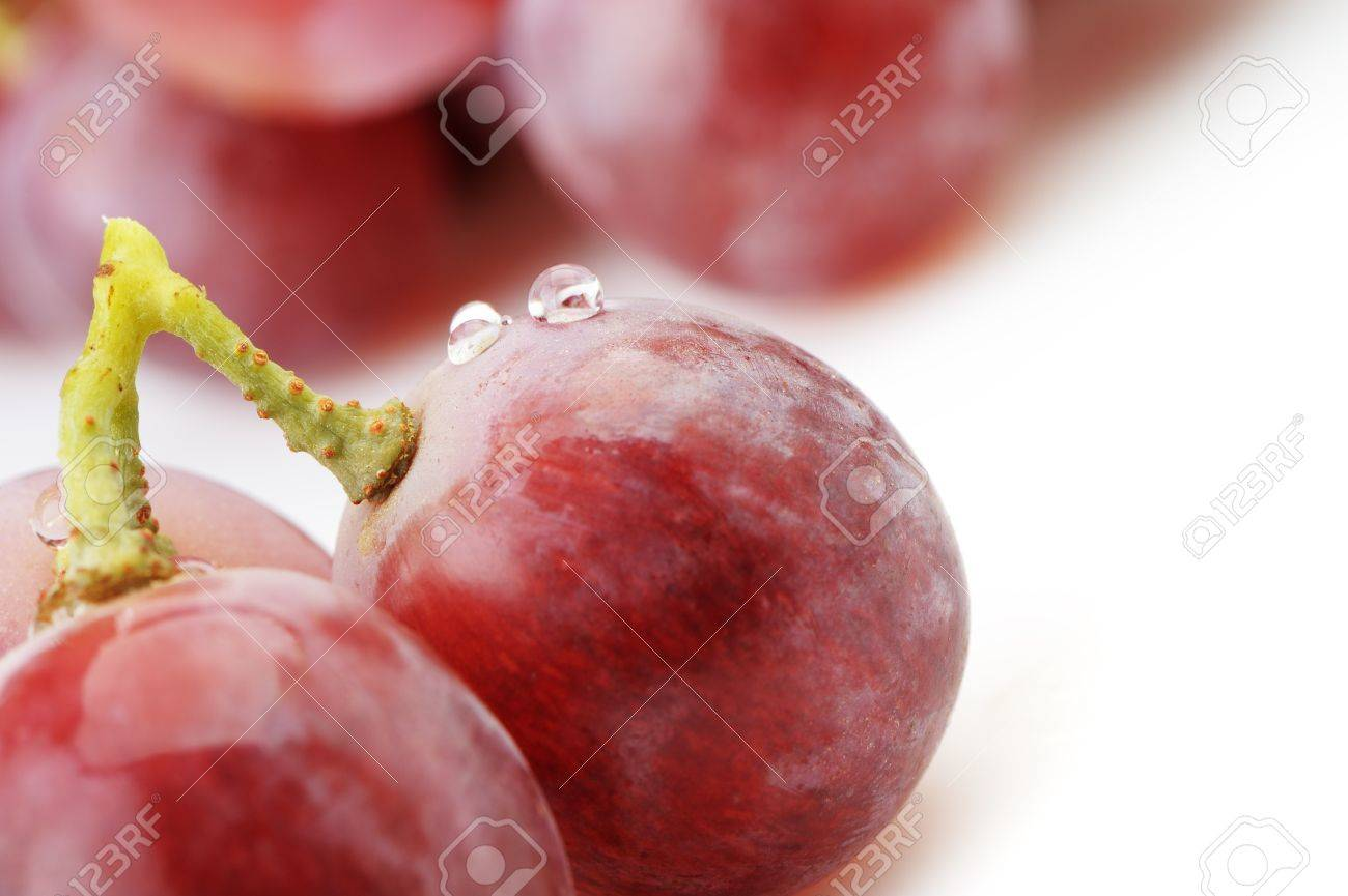 Grapes. Grapes berries in the foreground. It is isolated on a white background Stock Photo - 11787386