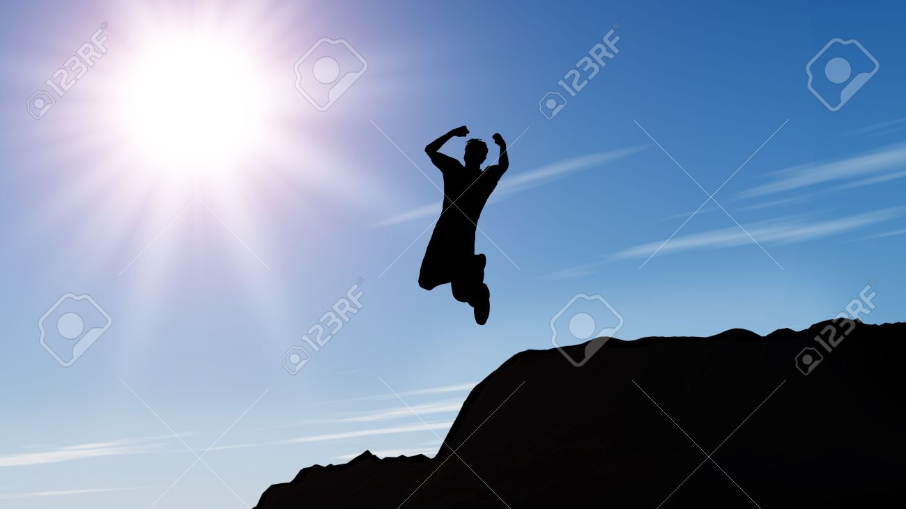 Silhouette of the jumping man from a rock. A shining sun with beams Stock Photo - 12700889