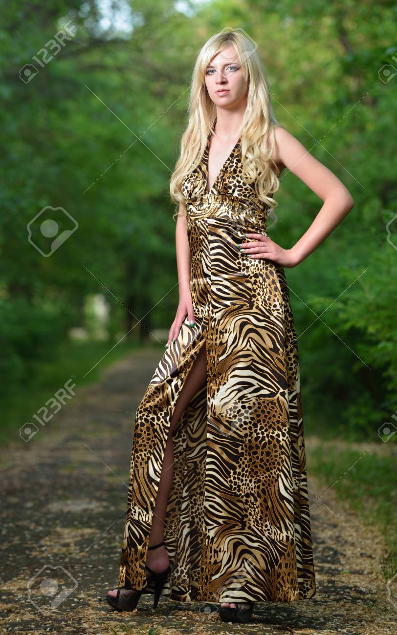 Portrait of a pretty woman in the Park. Shooting outdoors Stock Photo - 13664590