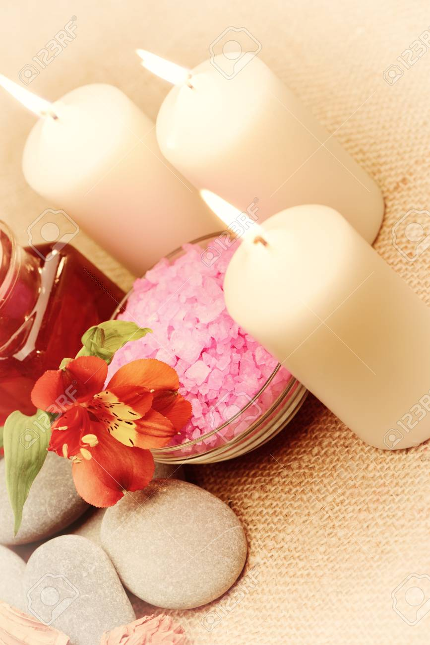 Object for the spa. Candles burning, pebble, a Lily, a bottle with oil, liquid soap, and more. Stock Photo - 13760158