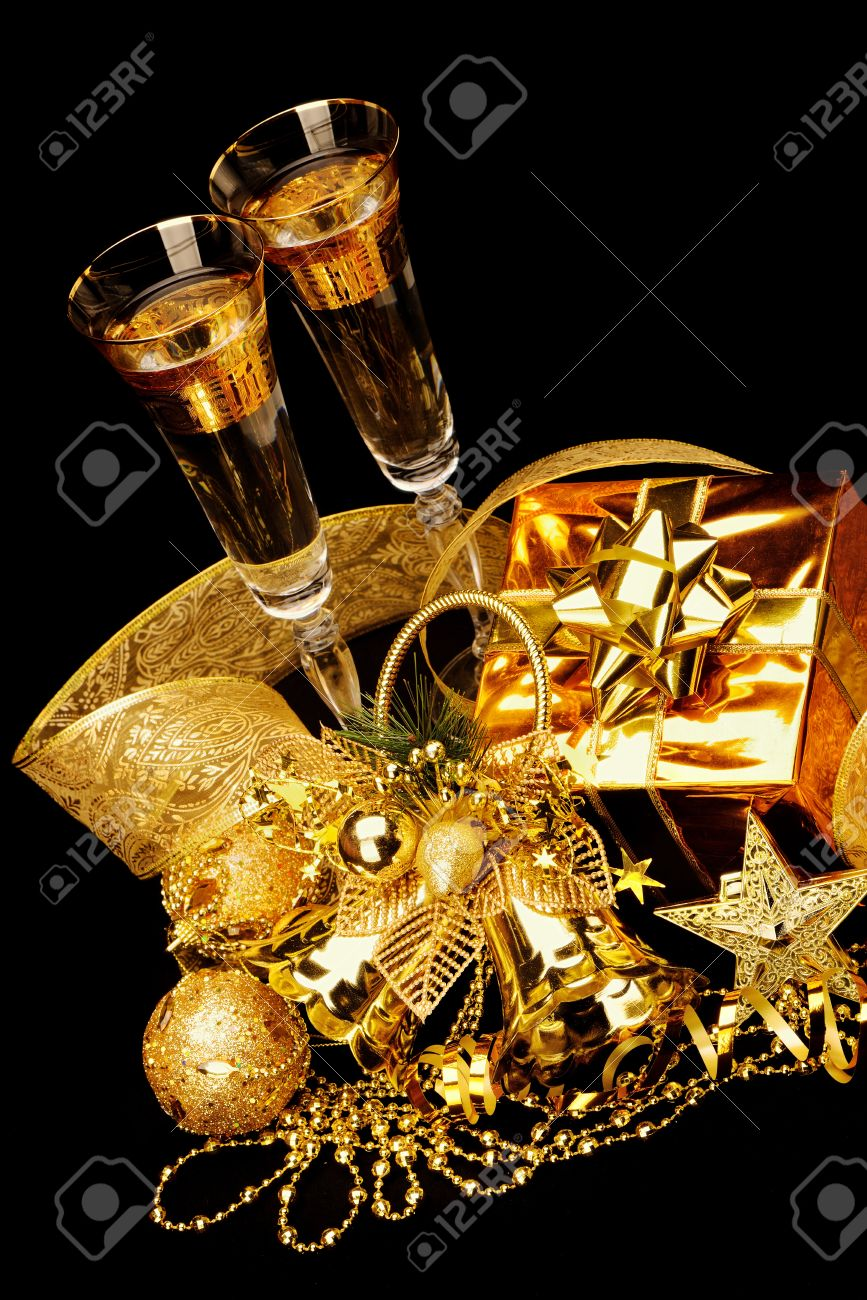 Black and gold christmas decorations - Gold Christmas Decorations Boxes Ribbons Stars Bells On Black Background Stock Photo