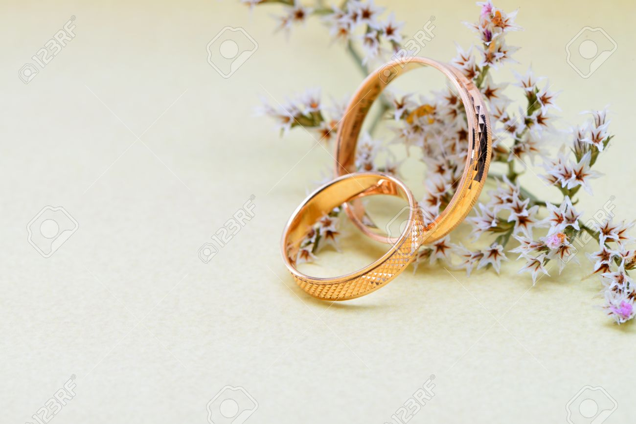Wedding rings flowers  Gold Wedding Rings And Branch Flowers. Holiday Postcard Stock ...