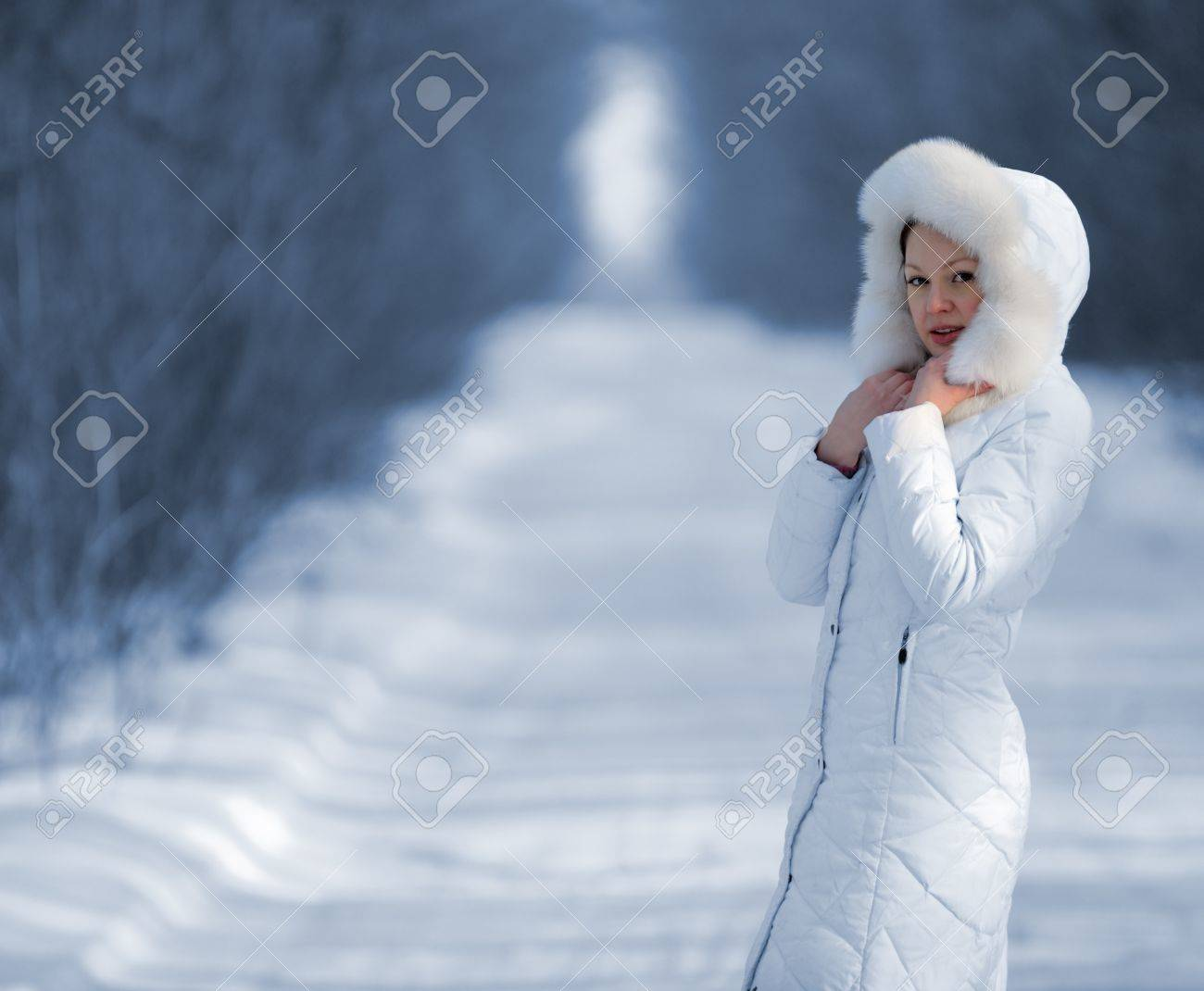 The woman in the winter white clothes. Cold toning Stock Photo - 16060916