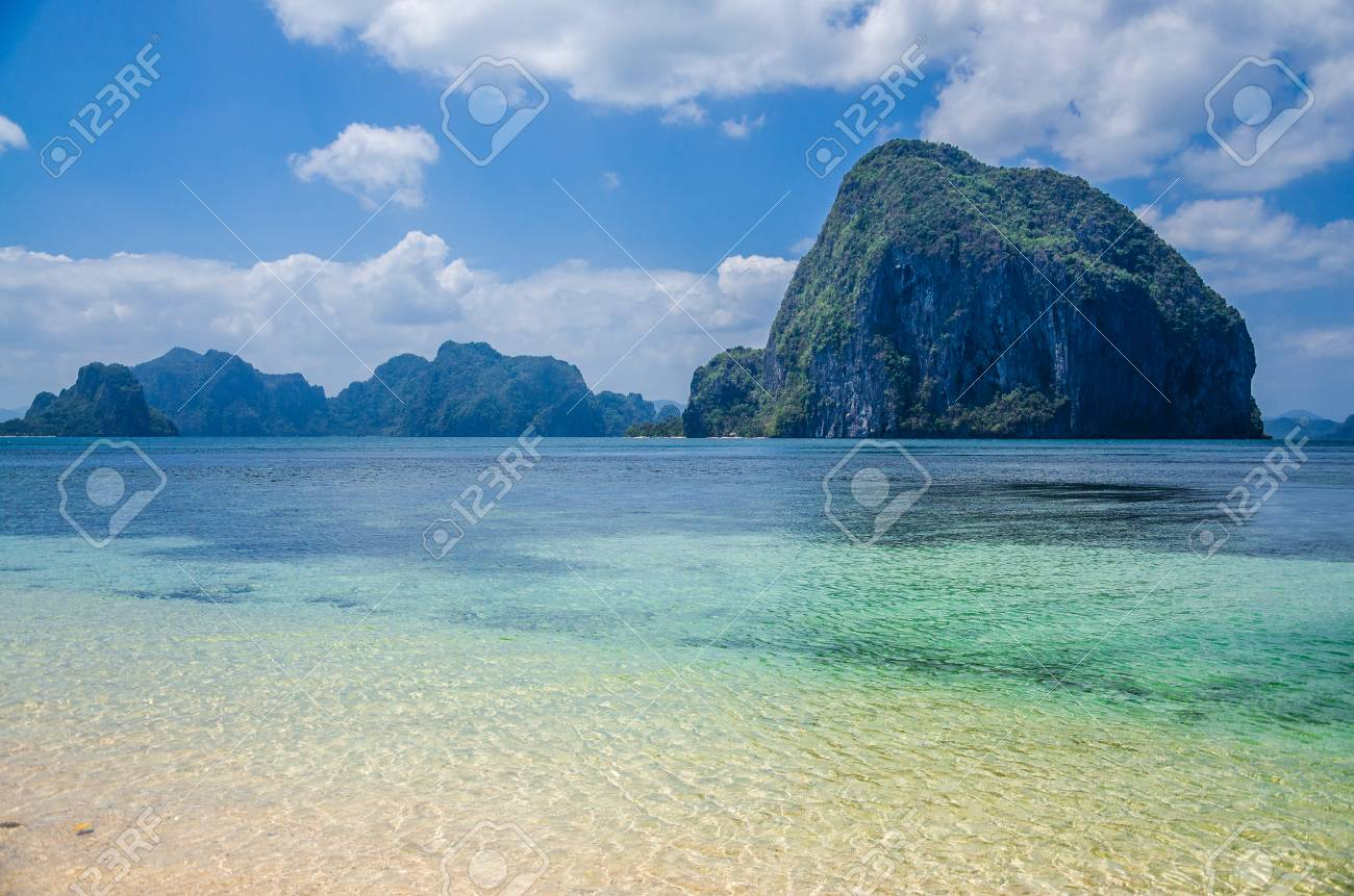 Huge Rock Of Pinagbuyutan Island In Blue Ocean Landscape Of