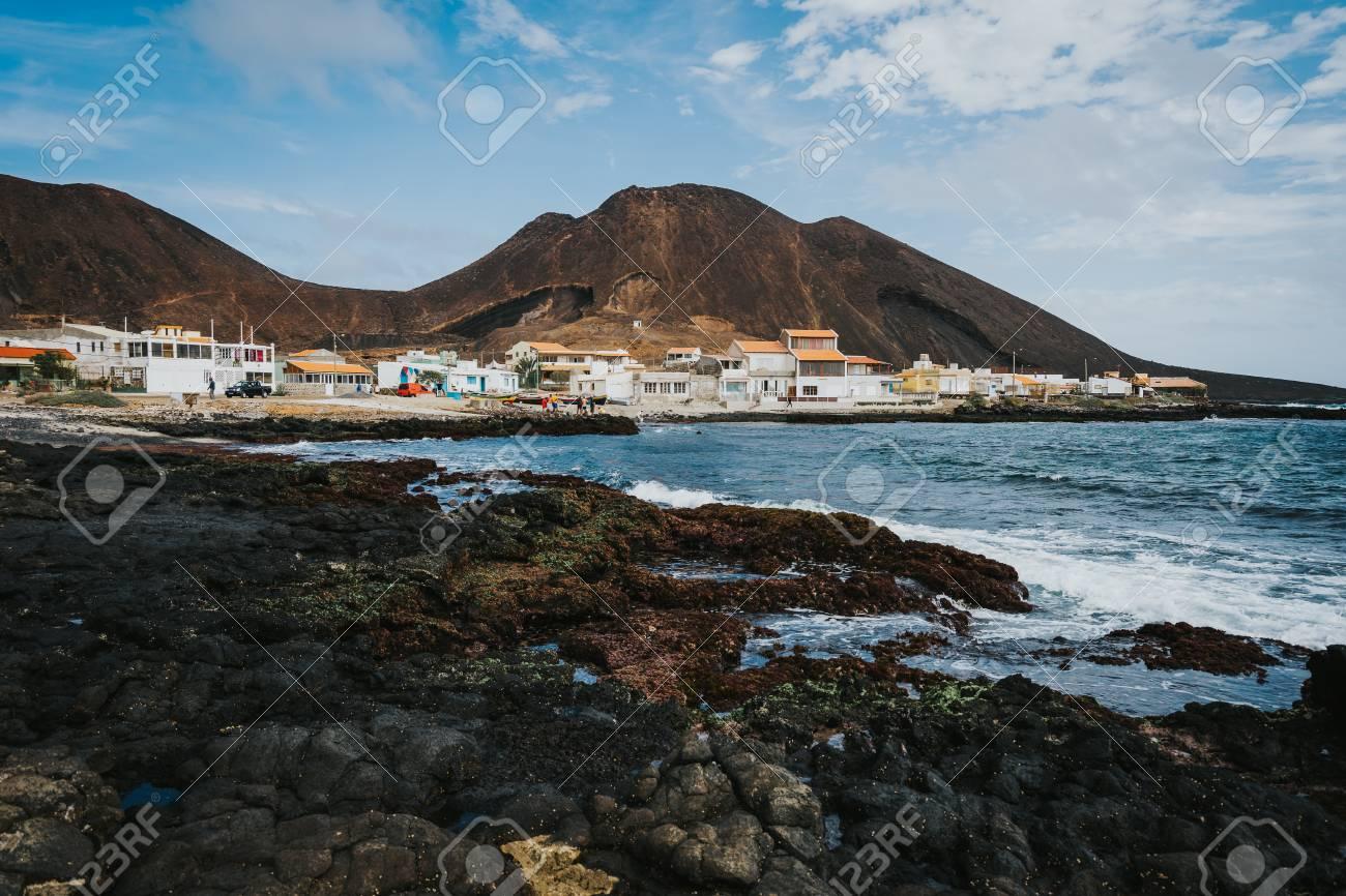 beauté réduction jusqu'à 60% le moins cher Calhau village on ocean coast in front of red colored volcanic..