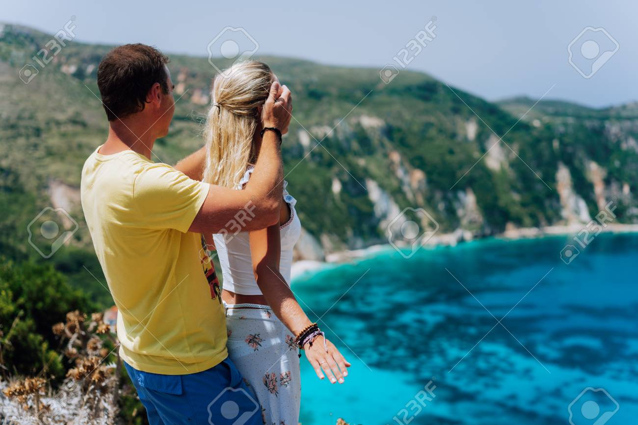 Birthday Gift Young Man Closing Hes Girlfriend Eyes In Front Of Gorgeous Seascape Panorama
