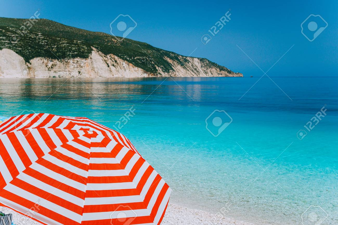 Image of: Beach Umbrella Intended Bright Red Striped Sun Beach Umbrella On Against Turquoise Blue Shallow Sea Water White Red Striped Sun Beach Umbrella On Against Turquoise