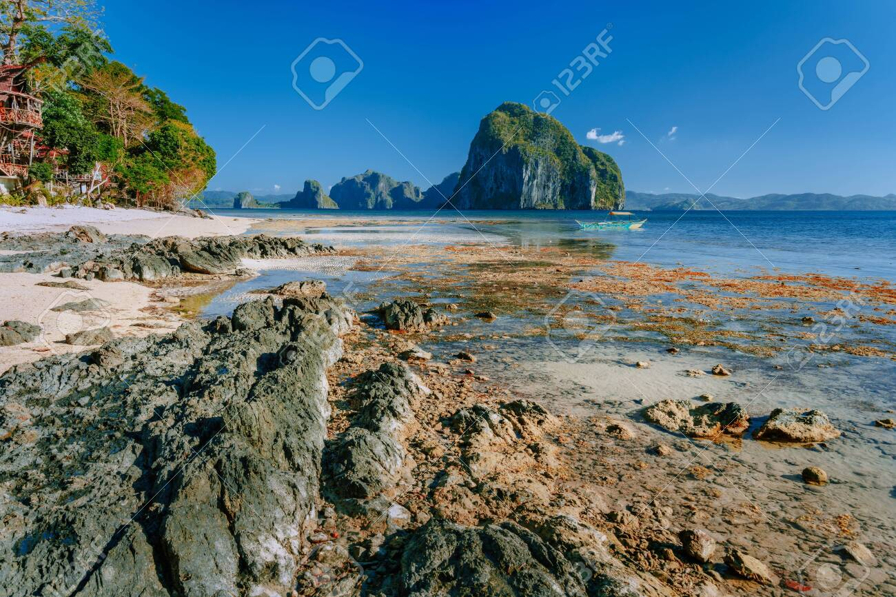 Rocky Exotic Coastline In Front Of Pinagbuyutan Island Dreamlike
