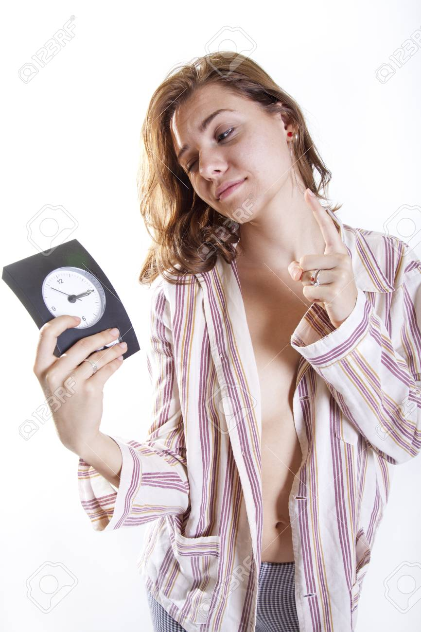 zoung attractive woman begging for one minute of sleep with clock in her hand Stock Photo - 15811401