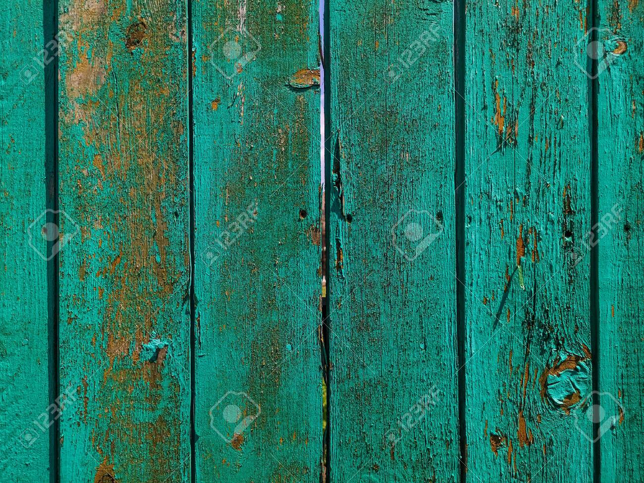 Green wood texture background. .Old ragged painted fence. - 150385336