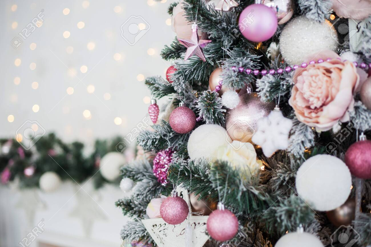Green And White Christmas Tree With Pink Toys New Year Winter Stock Photo Picture And Royalty Free Image Image 154089044