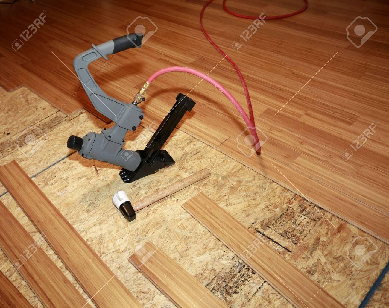 Installing hard-wood flooring - 44287723