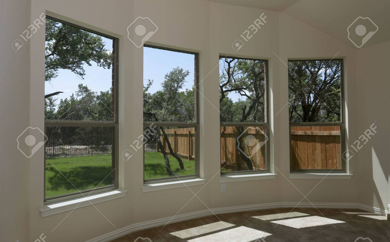 windows of new modern house with view on green backyard and new