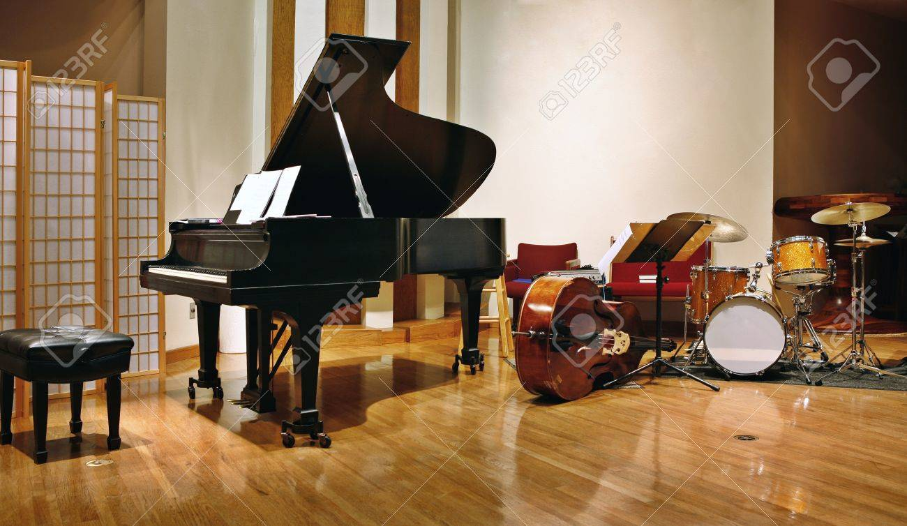 Grand piano, double bass and drams on stage ready for concert - 47615669