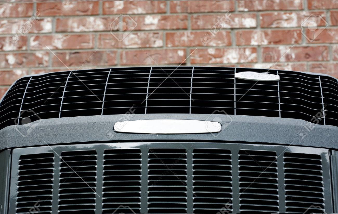 Close up shot of high High efficiency modern AC-heater unit on brick wall background - 55934741