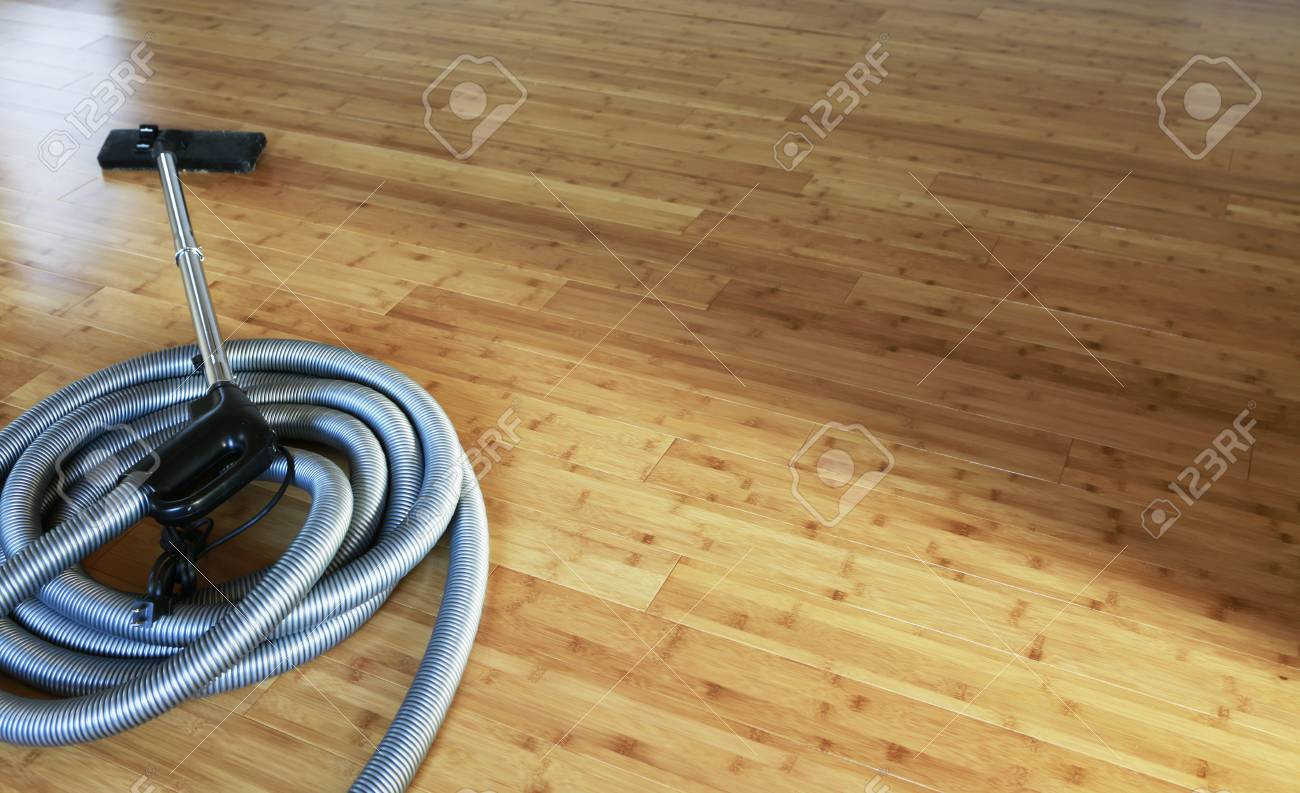 Beautiful bamboo hardwood floor with a central vacuum cleaner - 83418606