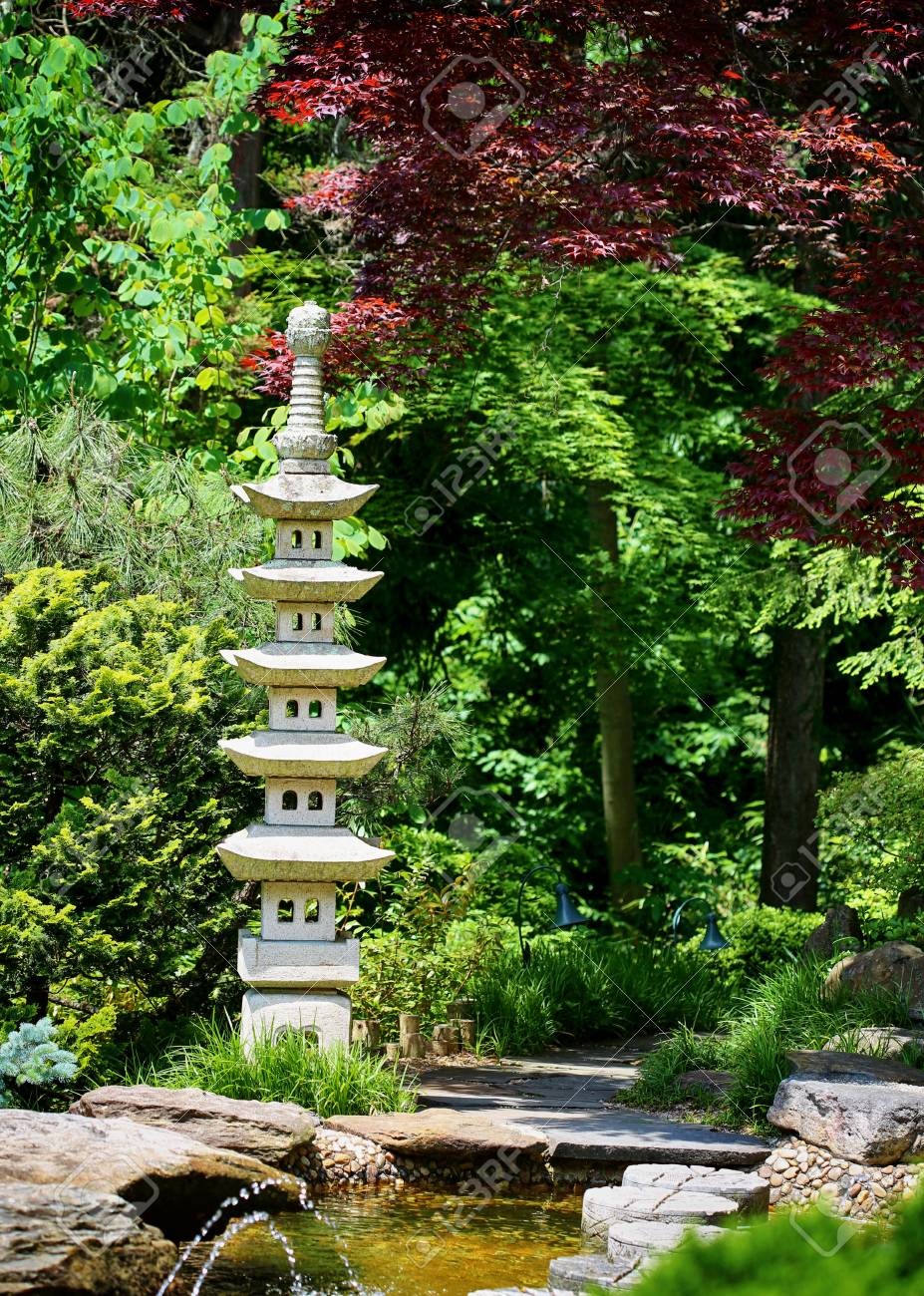 A Chinese Or Japanese Garden With Small Pagoda Sculpture Stock