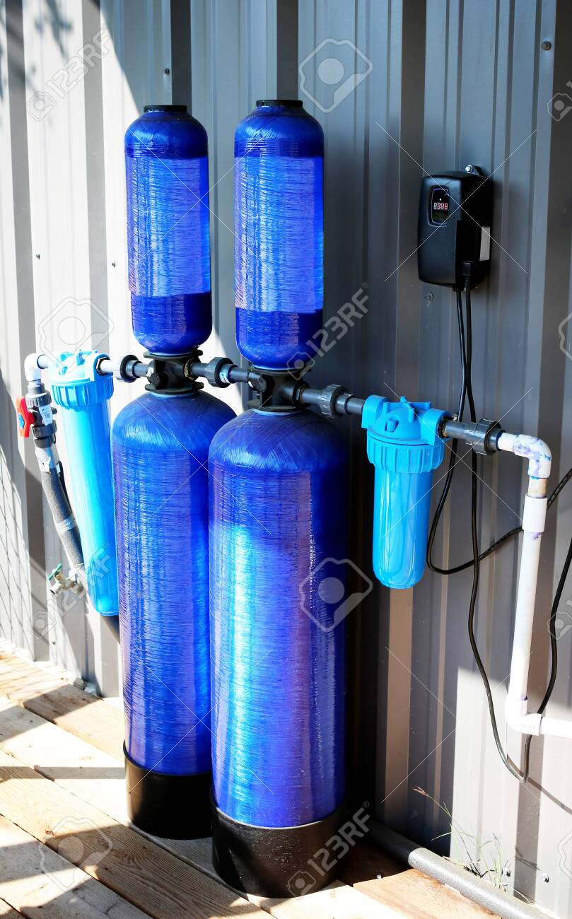 Whole house water filter - Modern reverse osmosis system outdoors on metal wall background. - 146490353