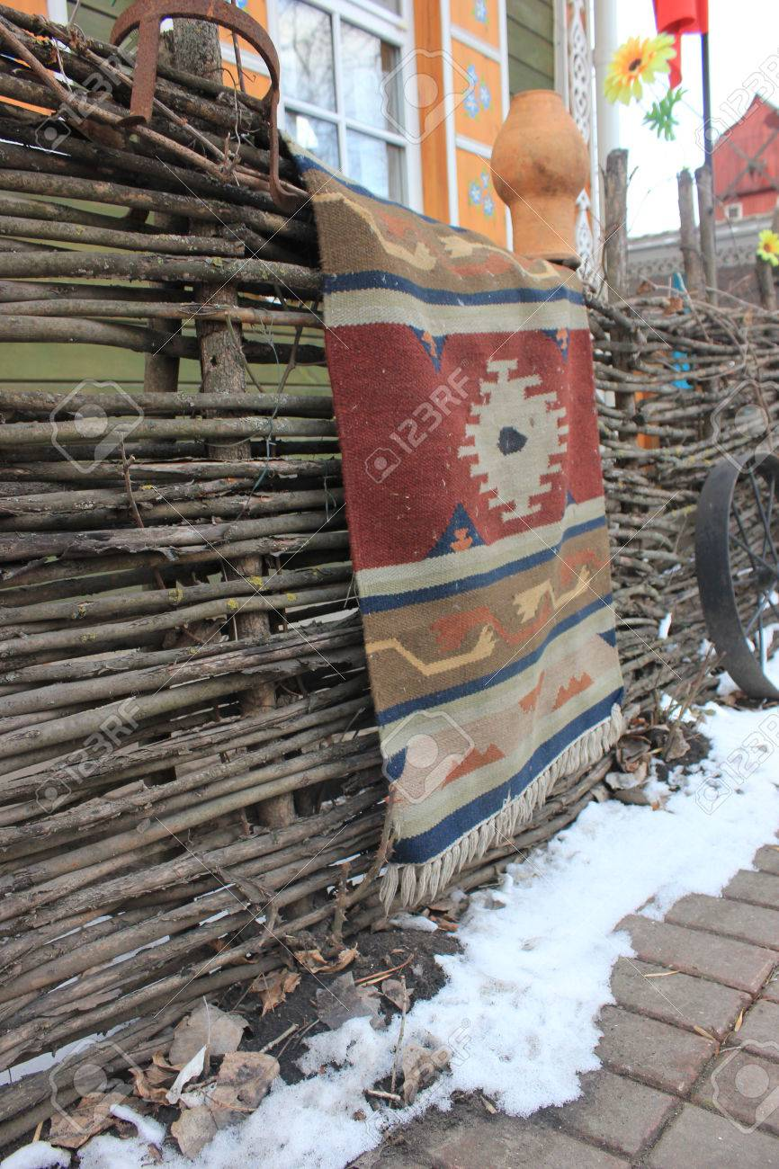 Homemade Braided Rug On The Fence In The Winter Snow