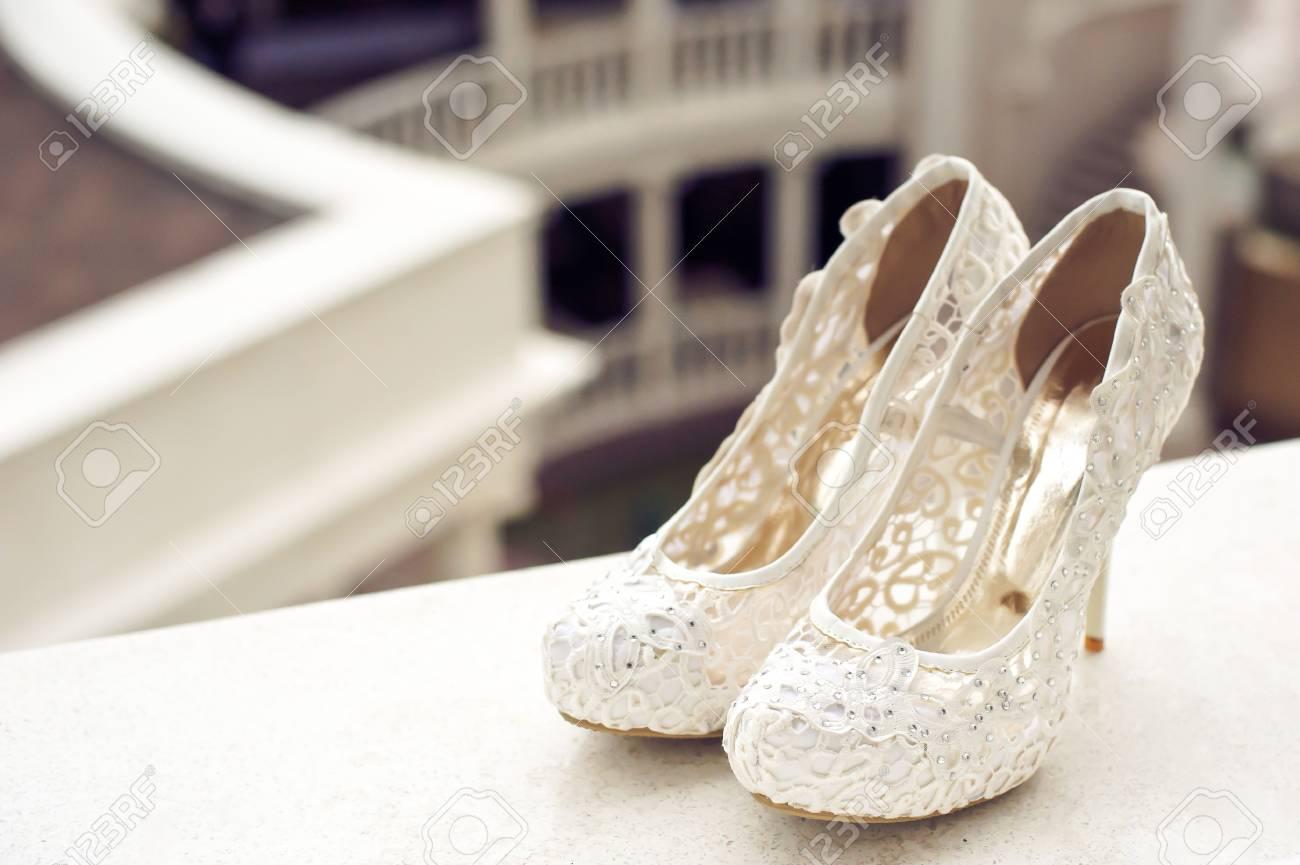 f1c3d6effd05b Wedding shoes cream color on the windowsill